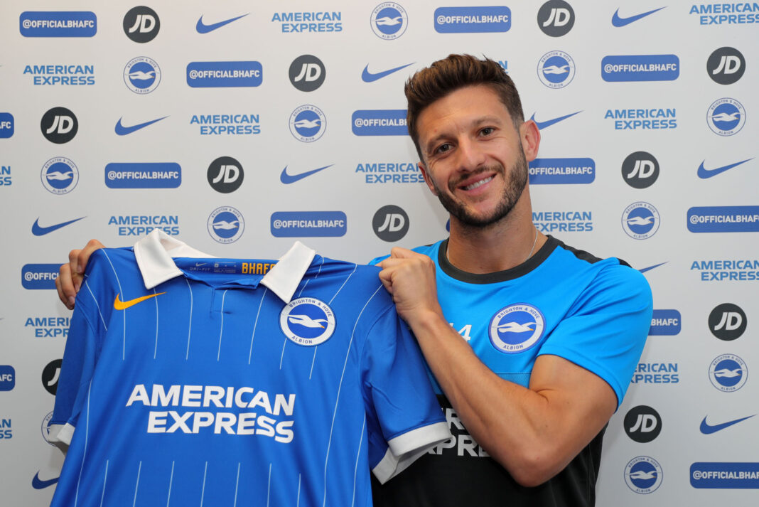 Brighton & Hove Albion have completed the signing of midfielder Adam Lallana from Premier League champions Liverpool