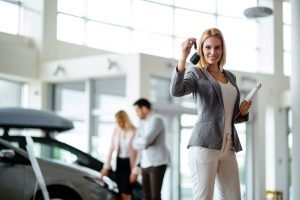 young-female-car-sales-consultant-working-in-showr