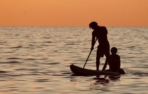paddleboarding SUP pair on the beach
